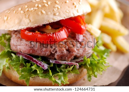sandwich with hamburger, peppers and vegetables