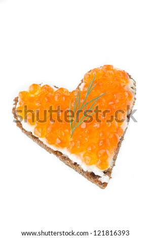 sandwich with red caviar in the form of a heart  isolated on a white background
