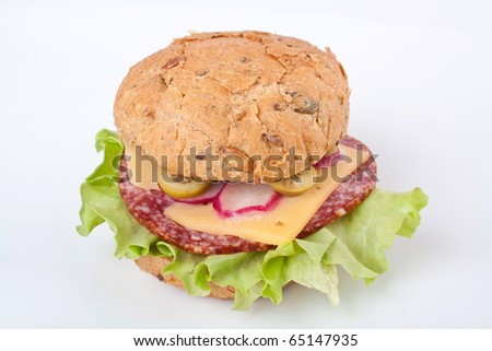 sandwich with salami, cheese and vegetables on white background