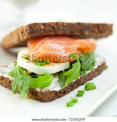 Sandwich with smoked salmon,eggs and arugula