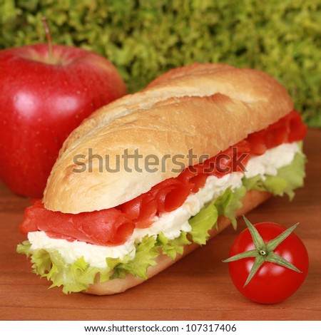 Sandwich with smoked salmon, tomatoes, lettuce and cheese