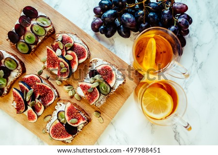 sandwiches with cheese grapes figs on wood #497988451