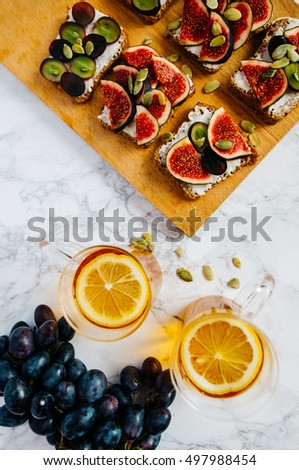 sandwiches with cheese grapes figs on wood #497988454