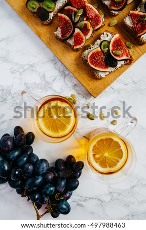 sandwiches with cheese grapes figs on wood #497988463
