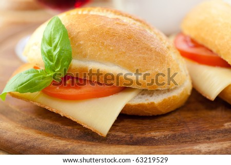 Sandwiches with french cheese and tomato