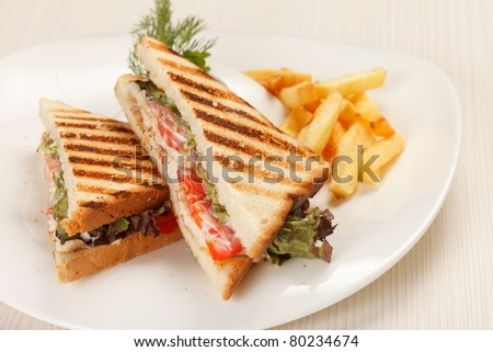 Sandwiches with French fried potatoes