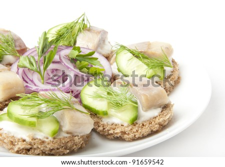 sandwiches with herring, cucumber and dill