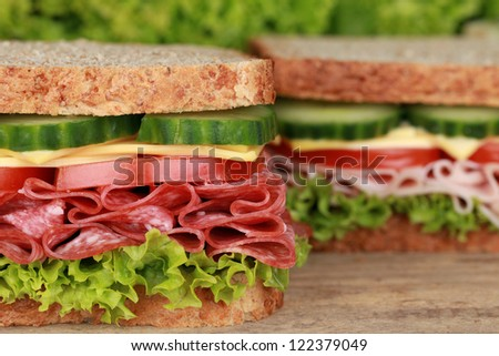 Sandwiches with pepperoni, ham, cheese, tomatoes, lettuce and cucumber
