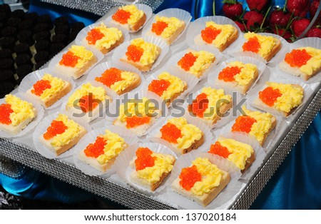 Sandwiches with red caviar and butter