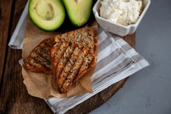 Sandwiches with soft cheese, avocado and cucumber. Breakfast is on the table. Healthy food. Toast and spread on it. Avocado sandwich stilllife. Healthy food. Toast.