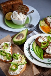 Sandwiches with soft cheese, avocado and cucumber. Breakfast is on the table. Healthy food. Toast and spread on it. Avocado sandwich stilllife. Healthy food.