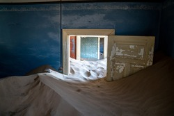 Sandy abandoned house close to the desert