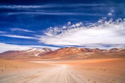 Sandy and gravel desert road through remote part of southern Altiplano, Bolivia