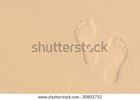 Sandy background with footprints on the beach : summer vacation concept