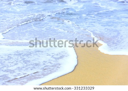 sandy beach and calm blue sea surf #331233329