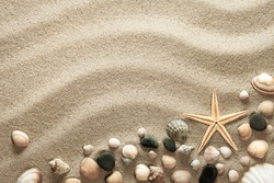 Sandy beach background with shells and starfish. Vacation concept. Top view
