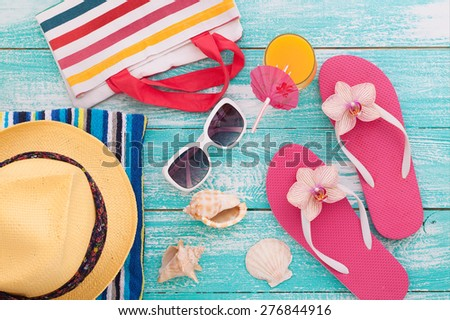 Sandy beach on sunny day with wooden walkway and beach accessories mock up for design