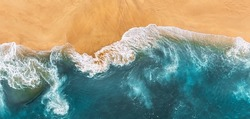 Sandy beach, panorama. Panoramic view of the sandy beach. The sea wave rolls on the shore. Sea coast view from the air. Aerial photography of the sea wave. The ocean and beach. Copy space