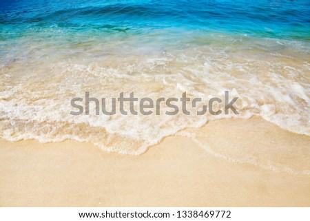 Sandy beach. Splashing waves on the seashore. Summer. #1338469772