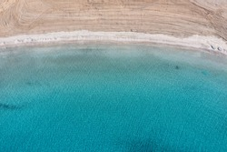 Sandy beach, turquoise blue color sea aerial drone top down view. Clear water, Platia ammos beach cleaned and empty, Koufonisi, Small Cyclades. Aegean greek islands summer vacations destination
