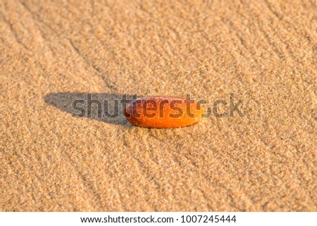 sandy beach with pebble and spray of the surf #1007245444