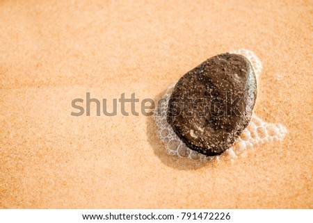 sandy beach with pebble and spray of the surf #791472226
