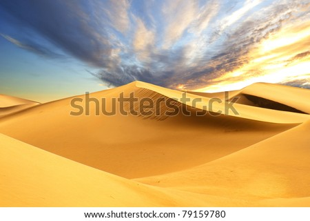 Sandy desert at sunset time - stock photo