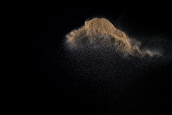 Sandy explosion isolated on black background. Abstract particles cloud. Texture element for design.