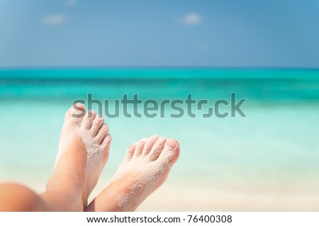 sandy feet on the beach