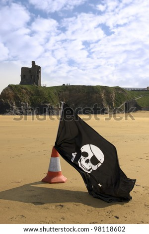 sandy golden beach with jolly roger flag in ballybunion county Kerry Ireland with castle in background