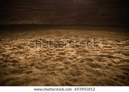 Sandy Horse Riding Arena with Light Spot in the Middle. Rodeo Photo Background.
