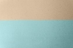Sandy Light brown split with soft light blue on craft cardboard box paper background. Beach scene concept
