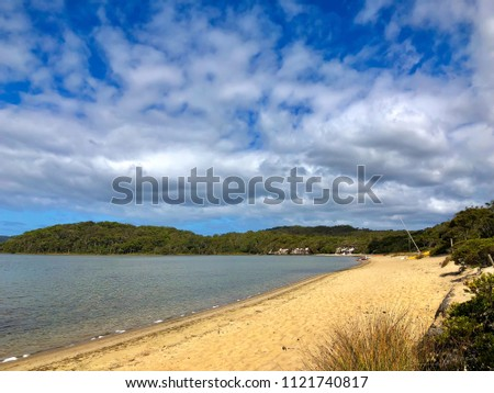 Sandy shore of Coalmine Beach, Nornalup Inlet in Walpole, Western Australia