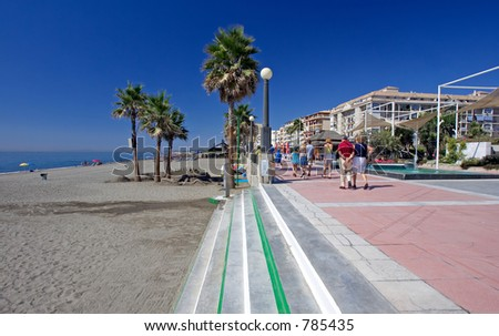 Sandy sunny beach and promenade at Estepona in Southern Spain on the Costa del Sol