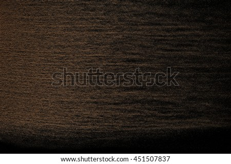 Sandy wave isolated on black background. Abstract sand explosion. Grainy texture. #451507837