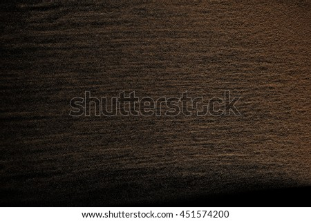 Sandy wave isolated on black background. Abstract sand explosion. Grainy texture. #451574200