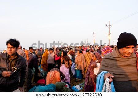 SANGAM, INDIA - JAN 27: People movement at time of celebration of Paush Purnima during the biggest hindu festival Kumbh Mela on January 27, 2013 in Allahabad, India. In 2013, Mela take 130 mill.people