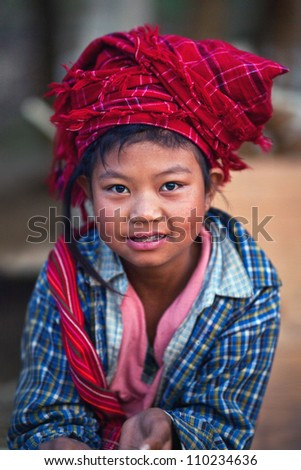 SANGHAR, MYANMAR - JANUARY 17: An unidentified 8-year-old Pa-O tribe girl Soe Soe,  during the local Htamanu Festival on January 17, 2011 in Sanghar Village, Shan state, Myanmar - stock photo