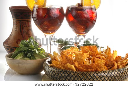 Sangria or fruit punch with tortilla chips and mole