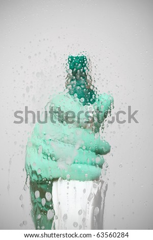 Sanitation worker spray cleaning agent on glass surface