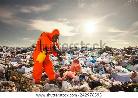 Sanitation worker working on the landfill