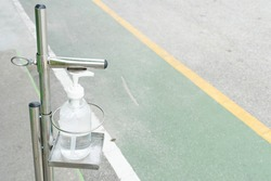 Sanitizer at the structural aluminum pedestrian walkway. Use the pedal instead of touching it with your hand.