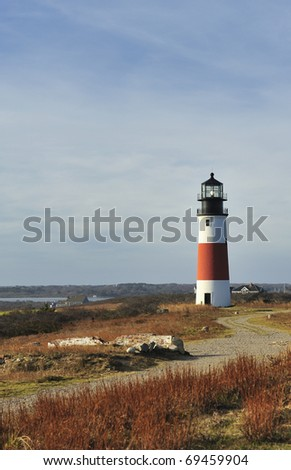 Sankaty Head Light Lighthouse on island of Nantucket Massachusetts USA built 1850 wide-angle view across the moors in autumn.The Sankaty Head Lighthouse was moved from edge of eroding bluff in 2007