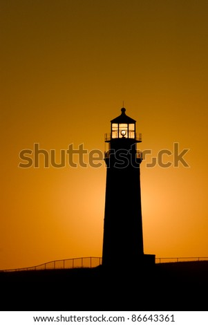 Sankaty head lighthouse at sunrise in the village of Siasconset on the eastern shore of Nantucket Island
