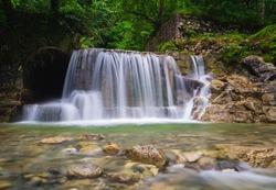 Sankt Gilgen waterfall in Austrian Alps, klausbach valley near attersee. Long exposure