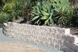 Sanstone like block retaining wall in residental area Australia