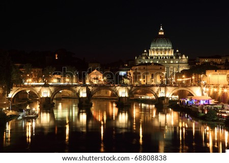 Sant' Angelo Bridge and Basilica of St. Peter at night in Rome, Italy
