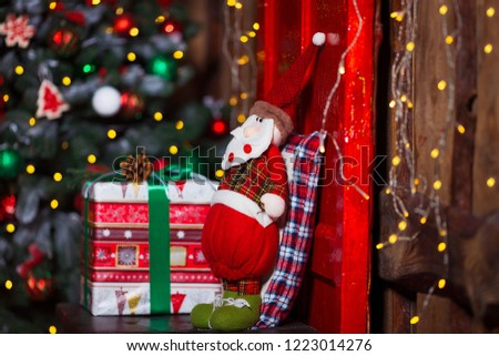Santa against blurred background. Christmas and home comfort concept. #1223014276