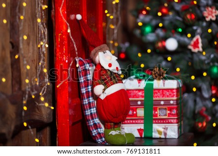 Santa against blurred background. Christmas and home comfort concept. #769131811