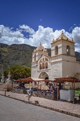 Santa Ana of Maca church surrounded by mountains in Colca Vale. Peru, Southamerica. Religion
